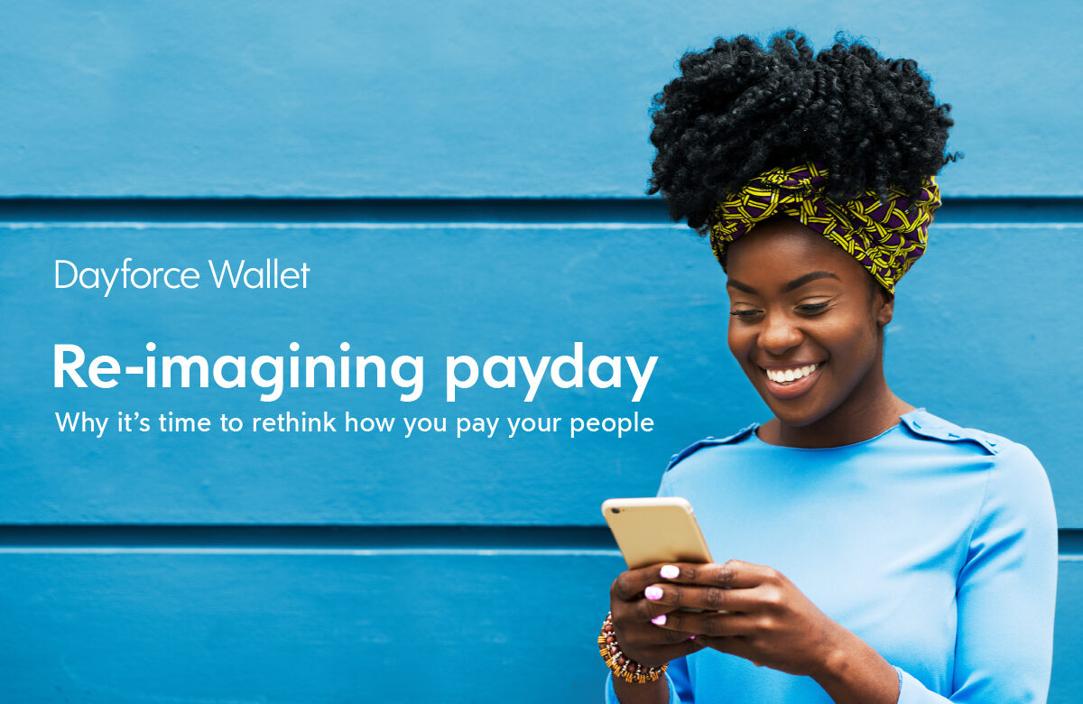 Black woman in front of bright blue wall using on demand pay app on mobile phone