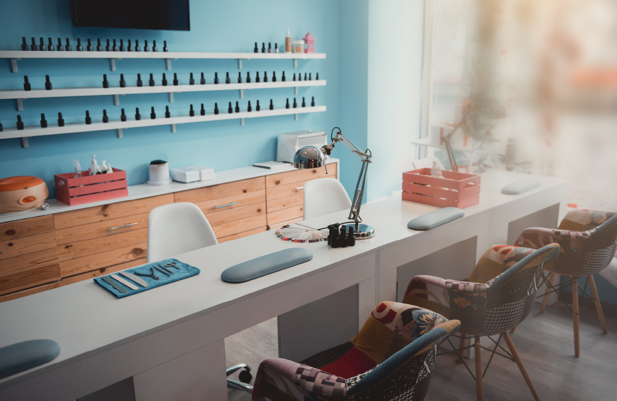 Photo of airy, modern nail salon with chairs on both sides