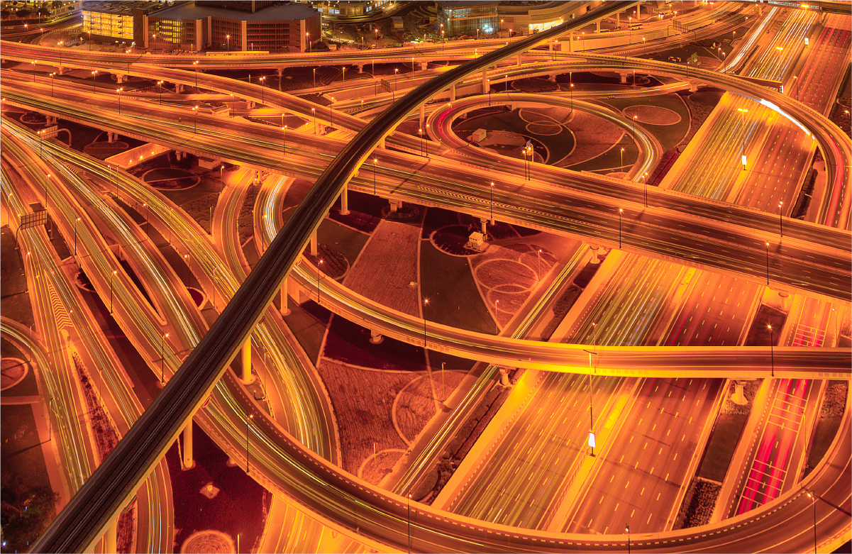 Abstracted photo of intersecting freeways in golden sepia tones