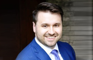 Photo of Adam Aguzzi, Human Capital Management for Manufacturing industry